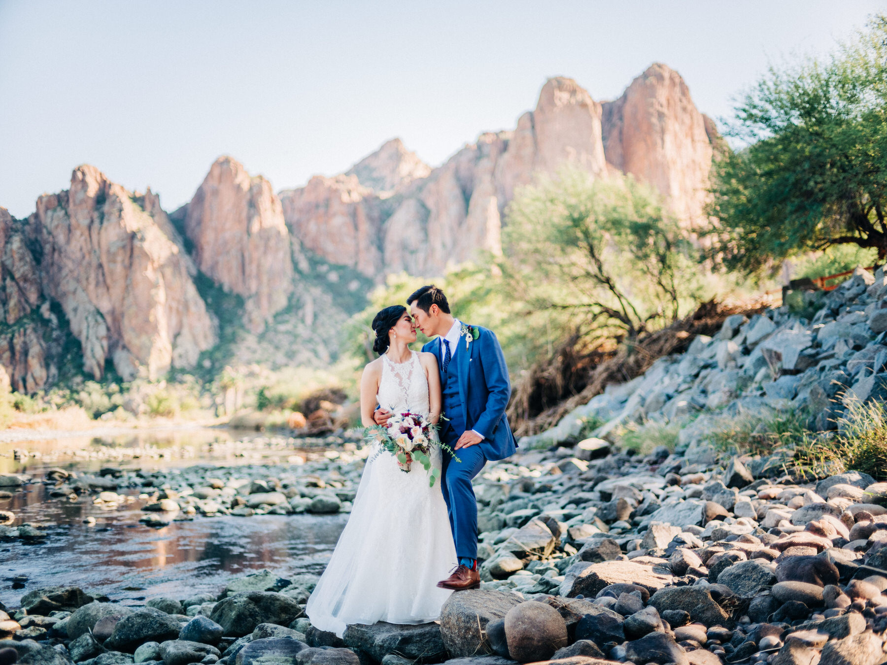 Bride and Groom on wedding day at the Salt river at the Saguaro Lake Guest Ranch