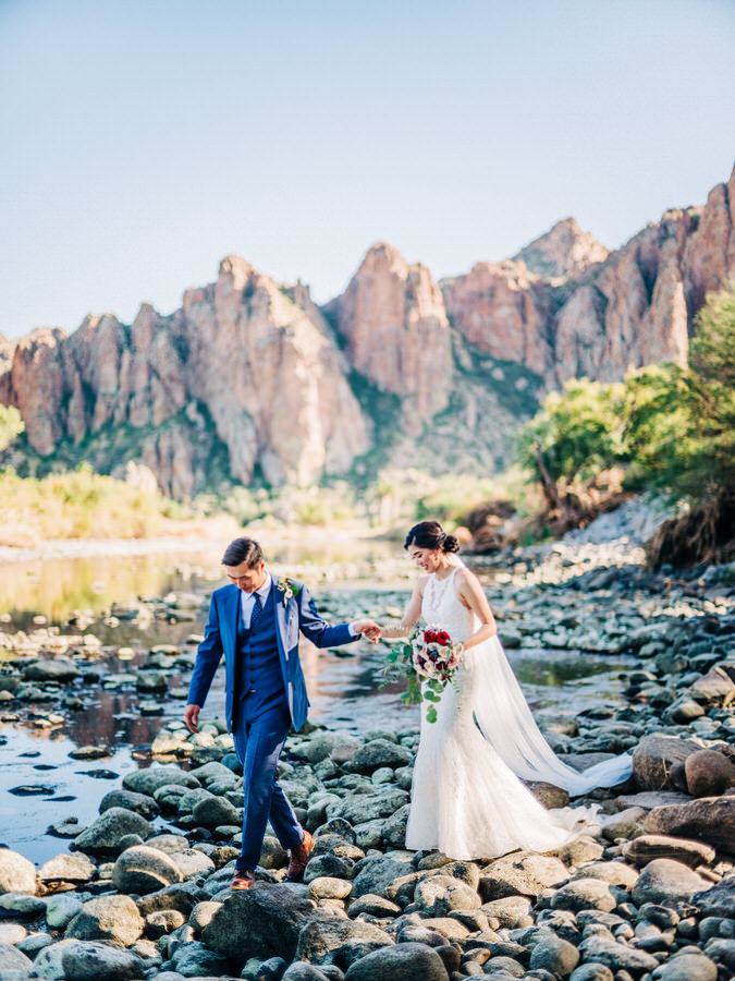 Bride and Groom walking at the river during Saguaro Lake Guest Ranch wedding