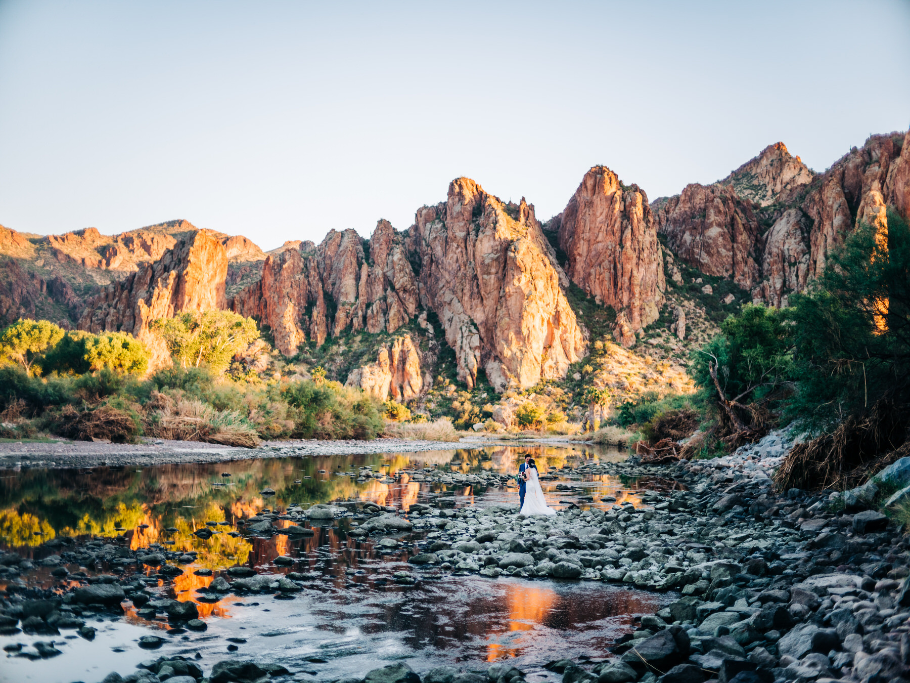 Salt River sunset with Bride and Groom under the mountains in Arizona