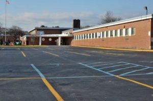 school with parking lot