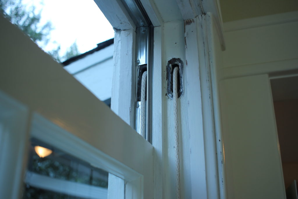 weather striping on upper sash of historic double hung window