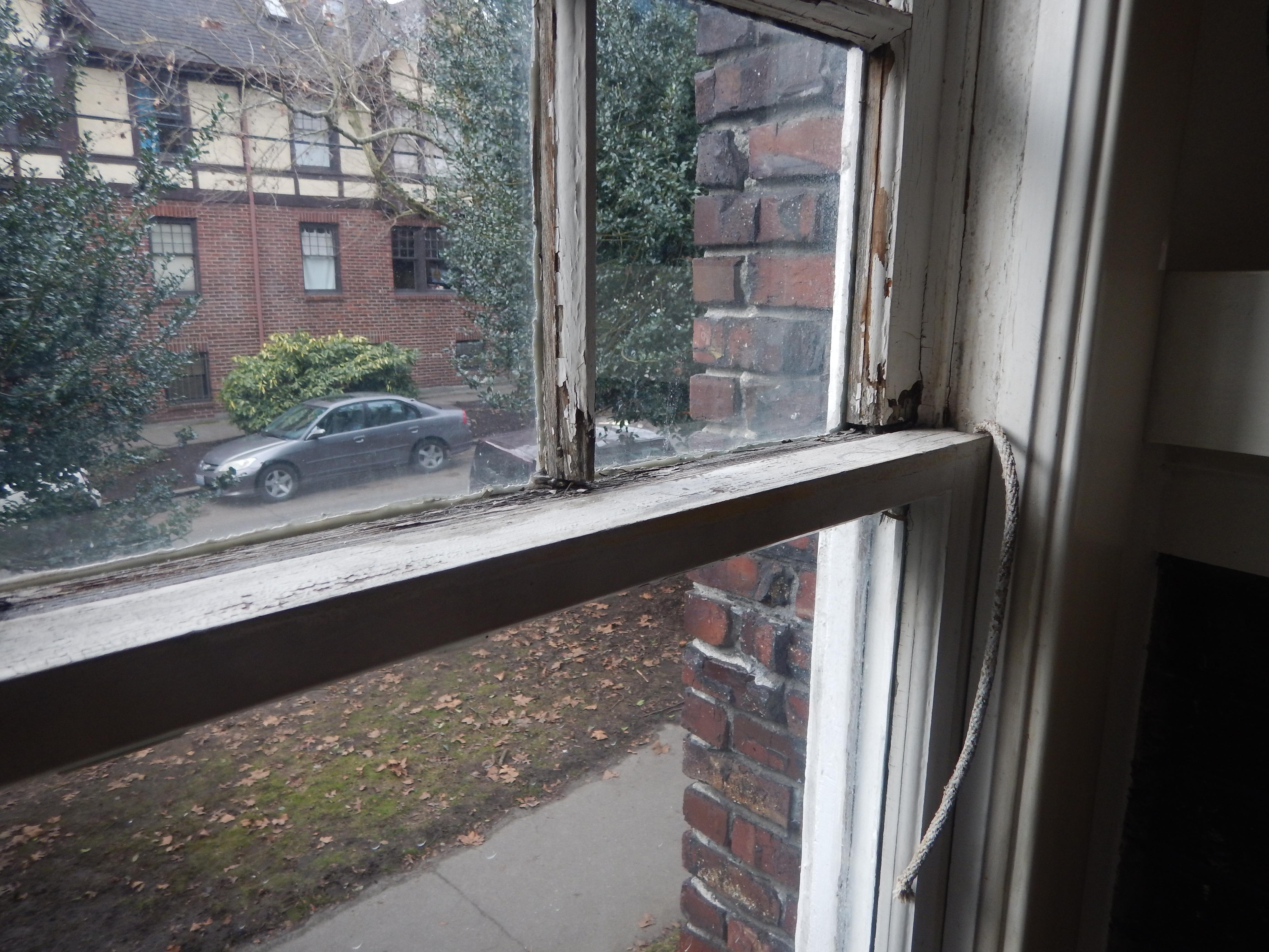 paint peeling from a wooden window
