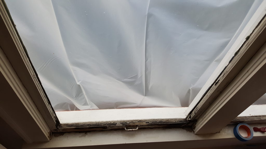 flaking paint on lower sash of a double hung window