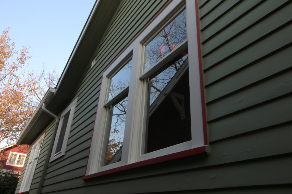 exterior photo of double hung windows. reflection off the glass