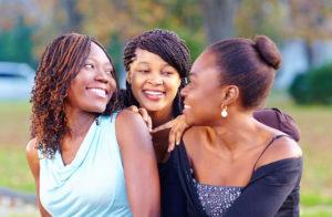 32315975 - happy african friends having fun outdoors