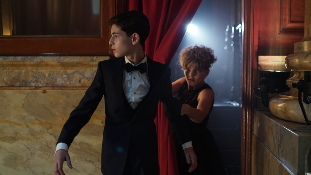 Selena helps Bruce find an escape route, but he won't leave Alfred behind.