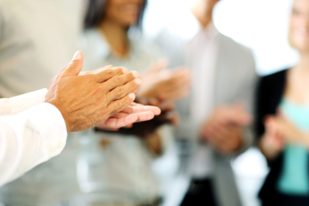 Close Up Of Business People Clapping Hands. Business Seminar Concept