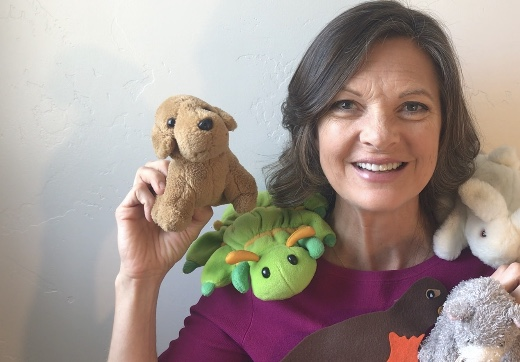 kristin with stuffed animals from her online toddler music class
