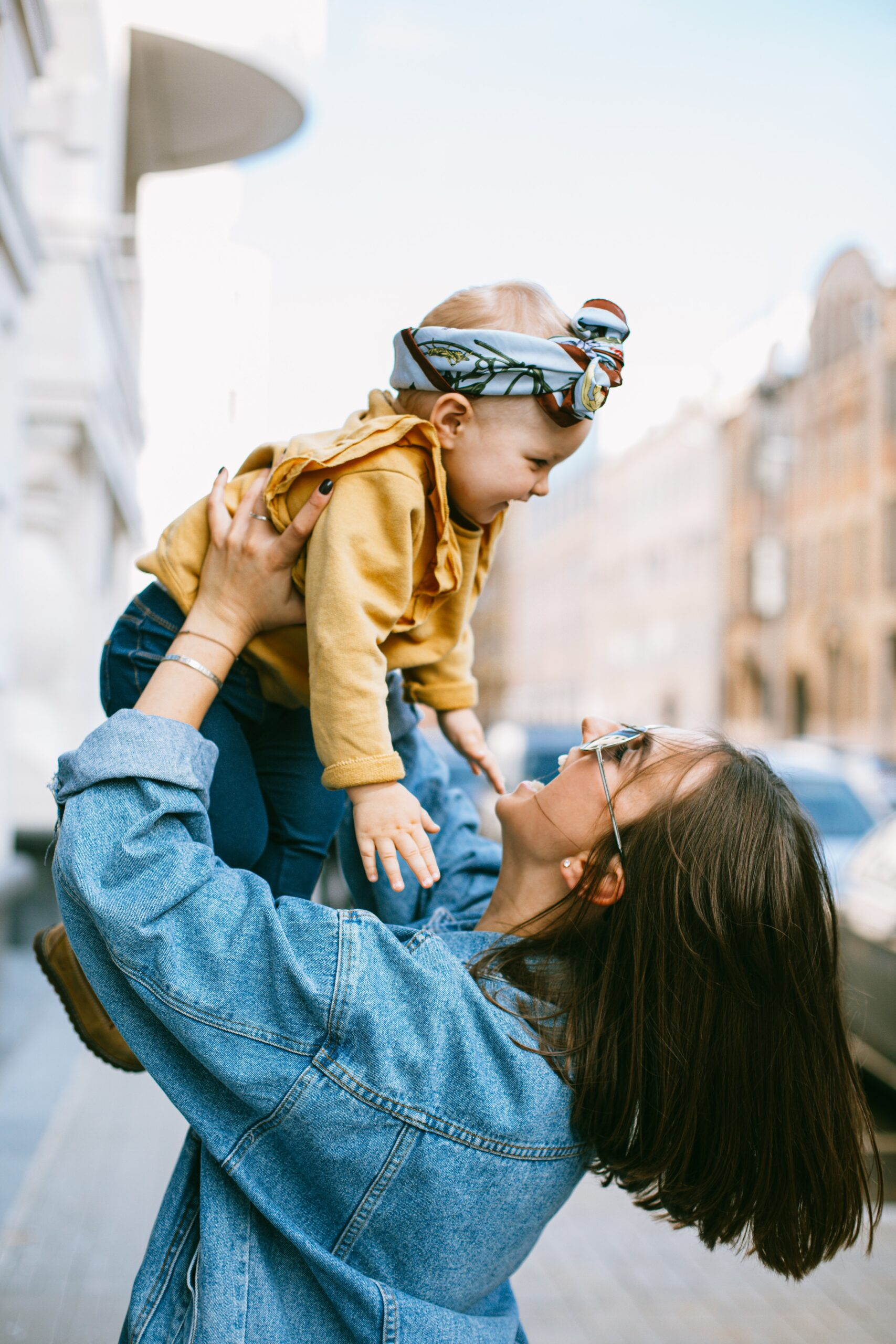 mother lifting her daughter in the air