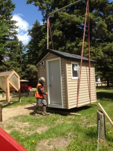June 6, 2014, Bringing in an outdoor bathroom shed for viewing and possible sales