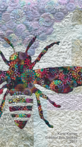 Image of Quilt with Bee.