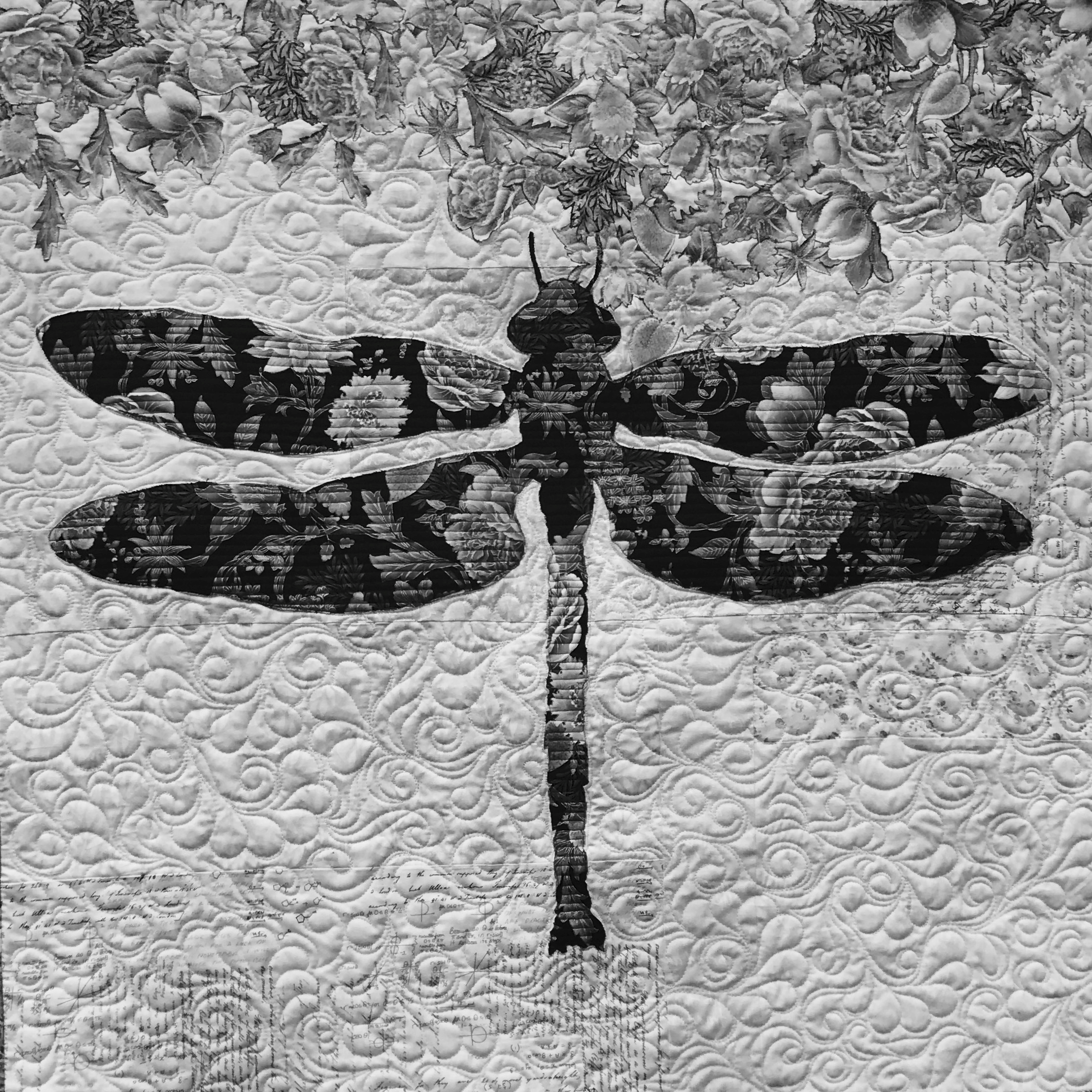 Image of dragonfly quilt in black and white.