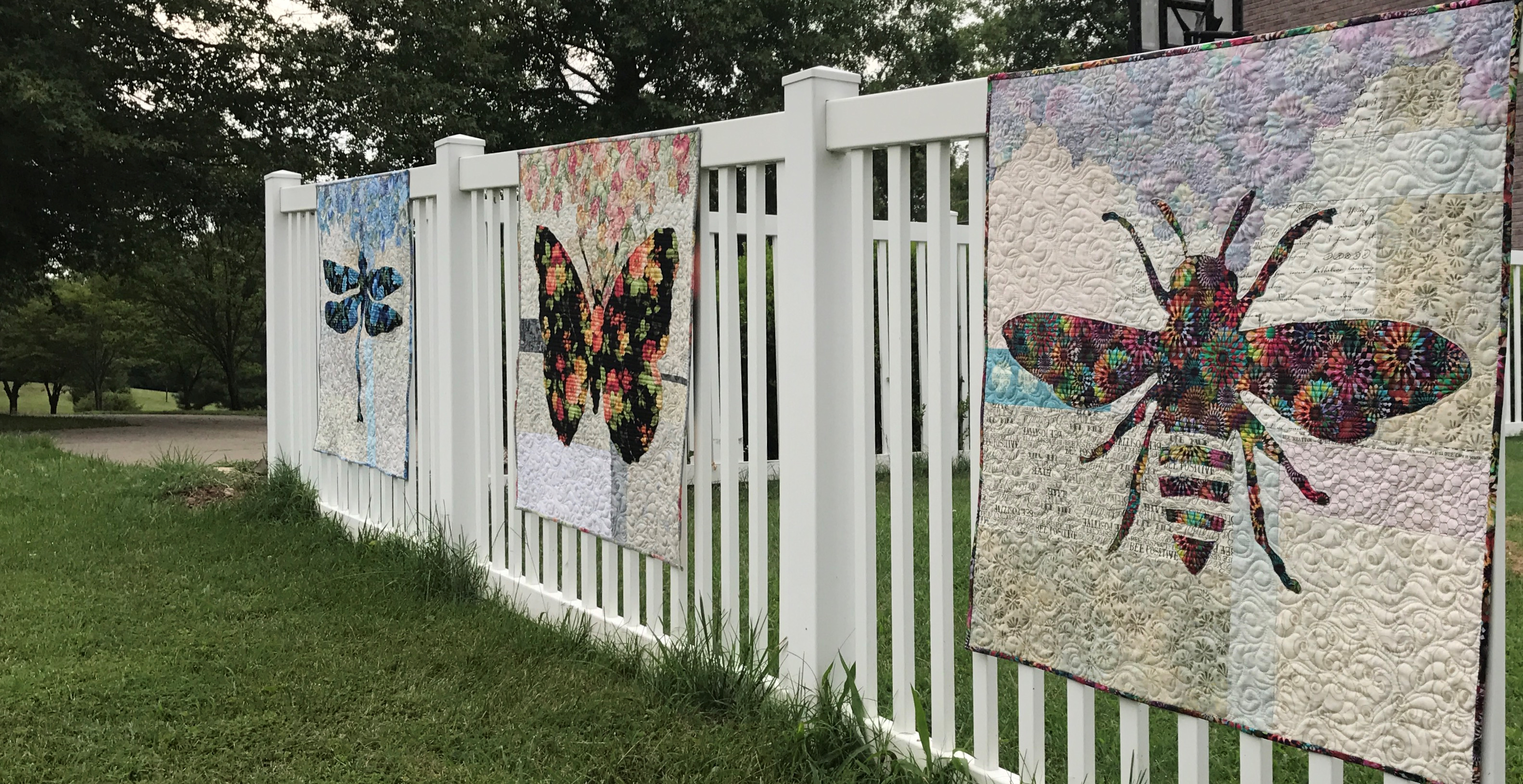 Image of Three Quilts on Fence
