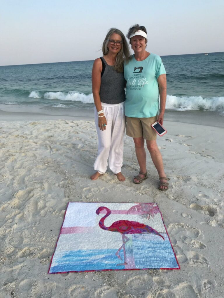 Image of Karla and Cheryl, quilters at the beach.