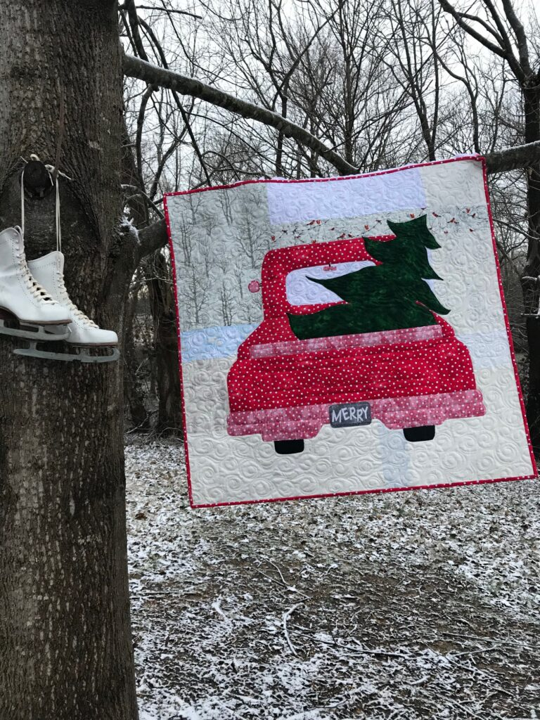 Image of Red Truck Christmas Quilt in Snow