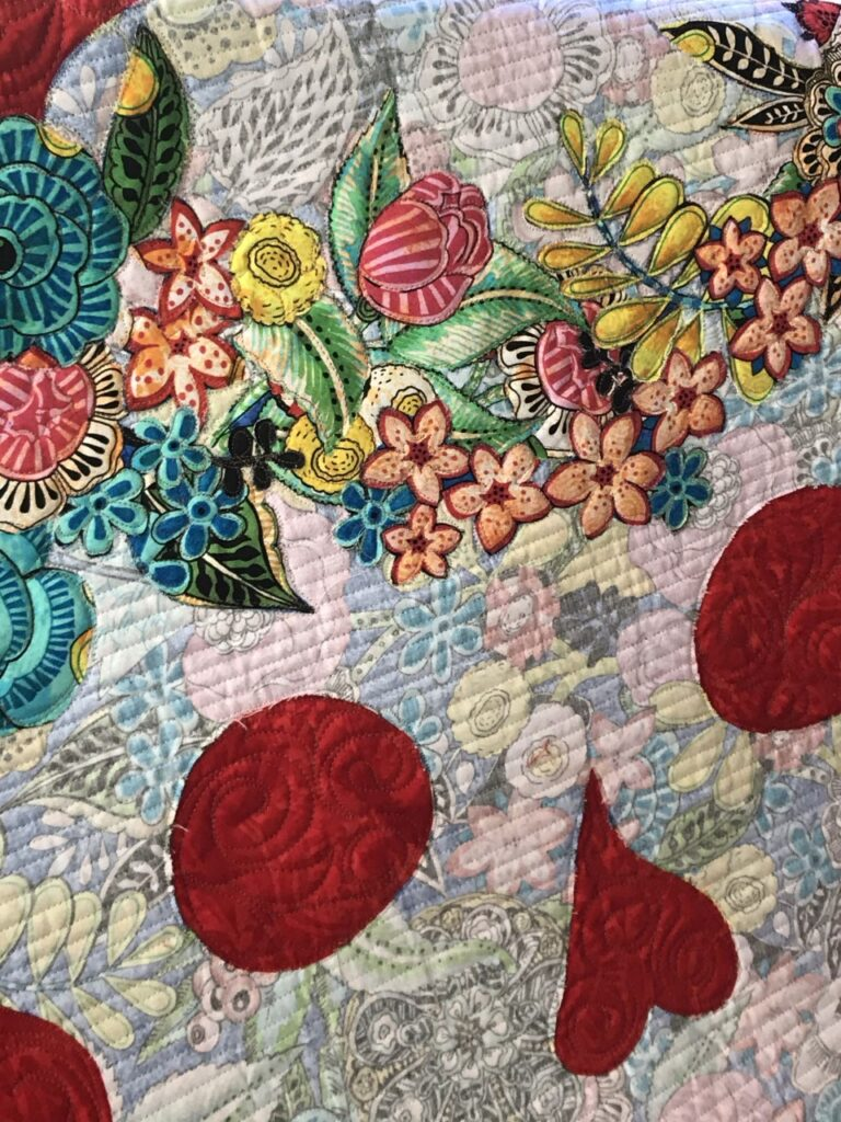 image of modern broderie perse quilt