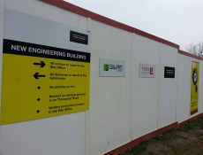 Wall mounted construction sign