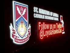 Electronic Message Center Sign - Loyola sign at night