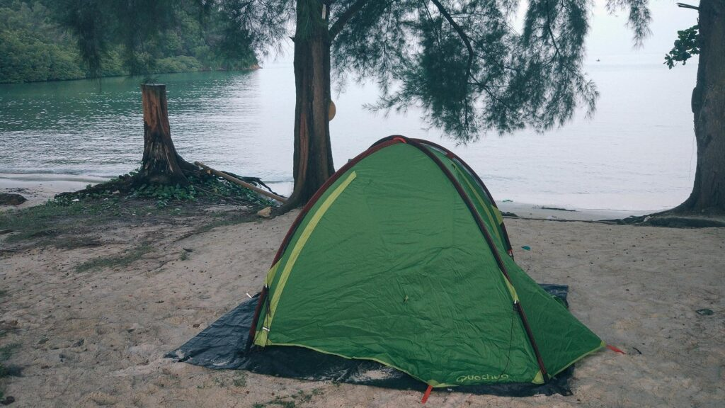Green tent on a beach