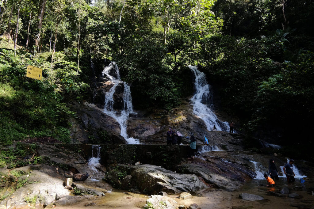 Group of people playing at the twin waterfall