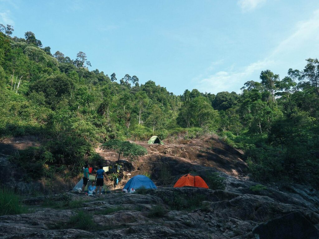 Tents set up on a rocky cliff with limited flat ground
