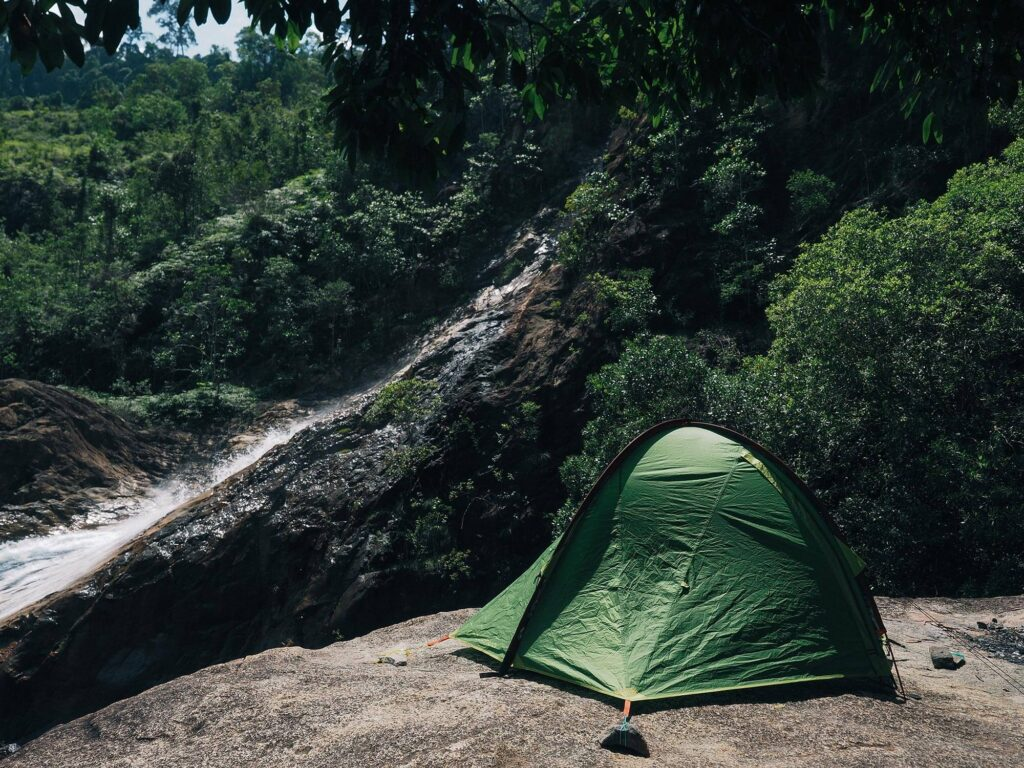 Camping beside a waterfall
