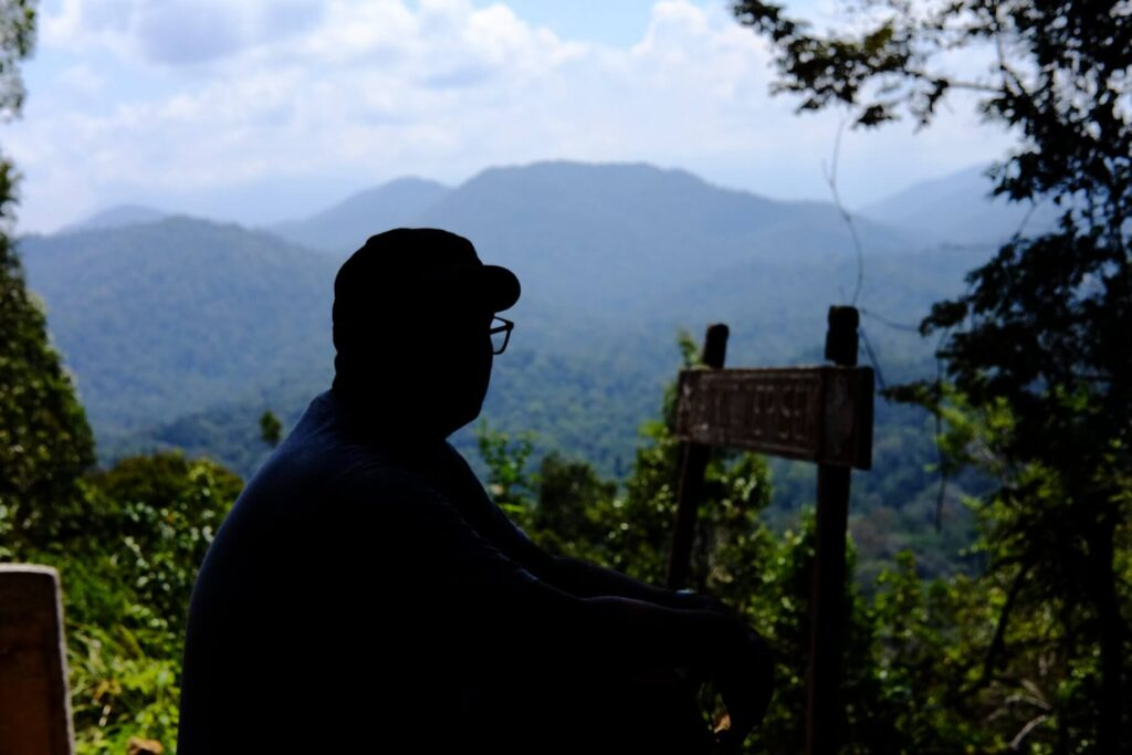 Man looking at layers of mountains
