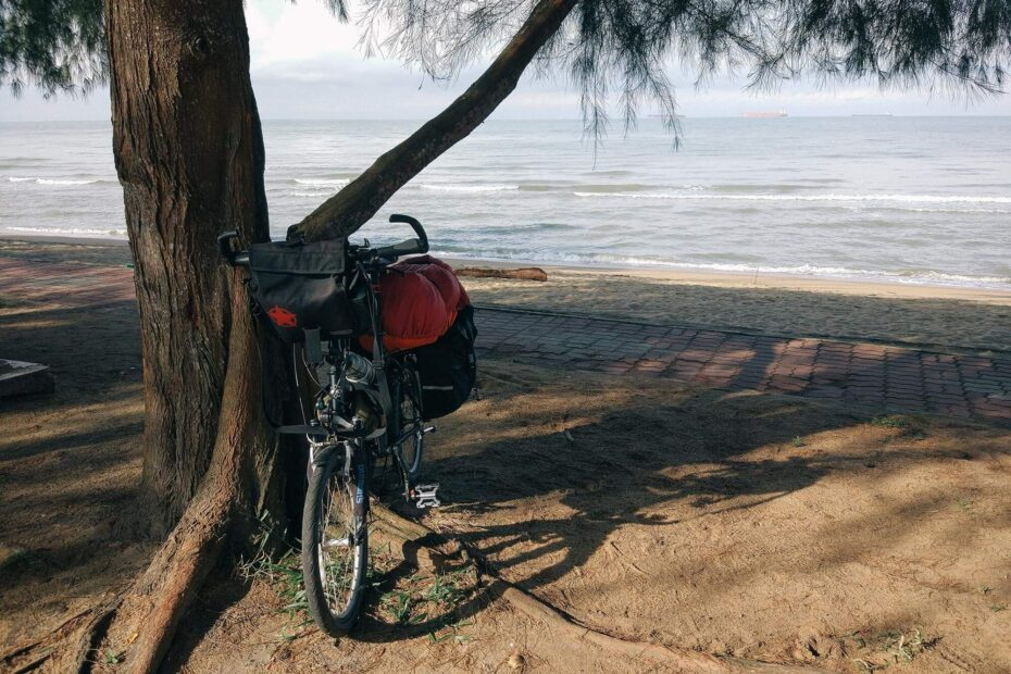 Foldable touring bicycle stopped by the beach