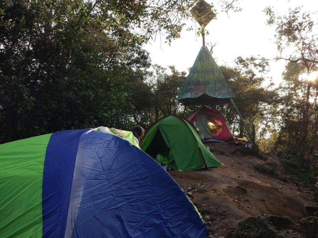 A few tent set up on the mountain peak