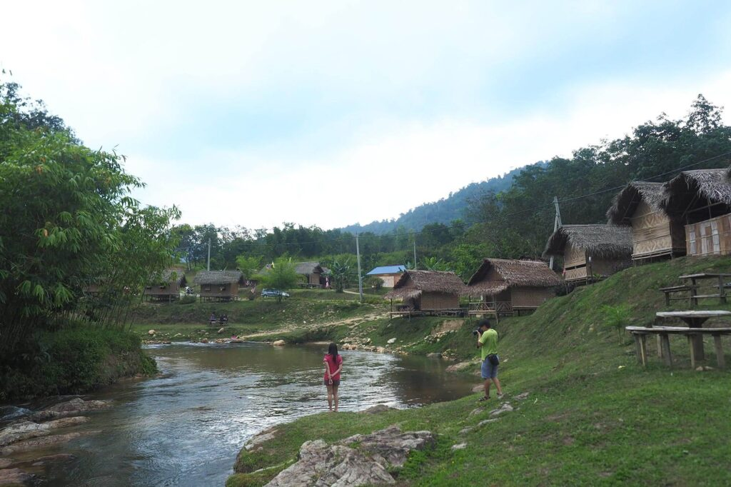 A few huts beside the river