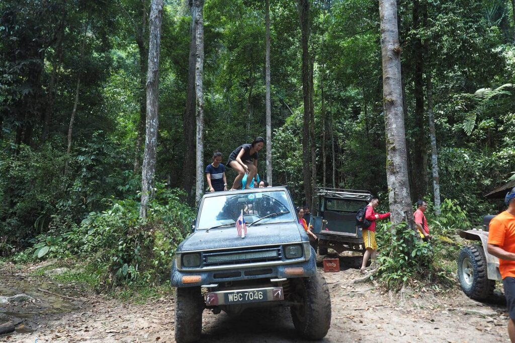 A women sitting on top of the 4wd