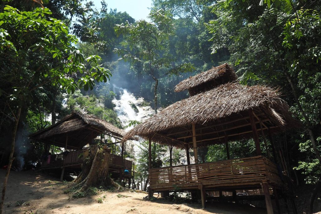 Bamboo hut with waterfall in the background