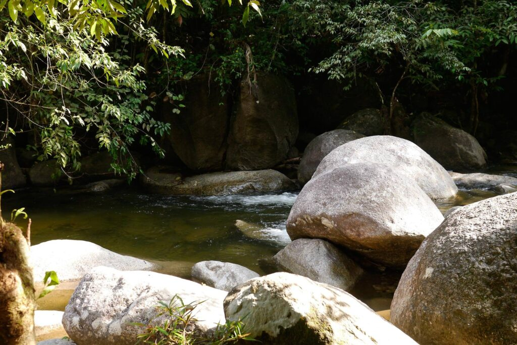 River with large boulders and crystal clear waters
