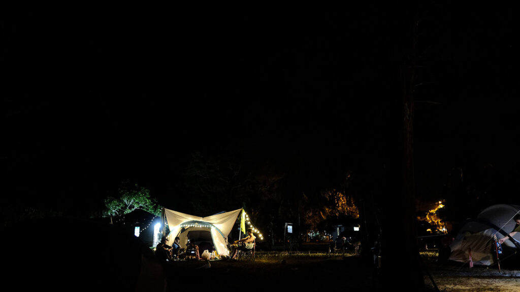 Night time at the camping ground with tents light up