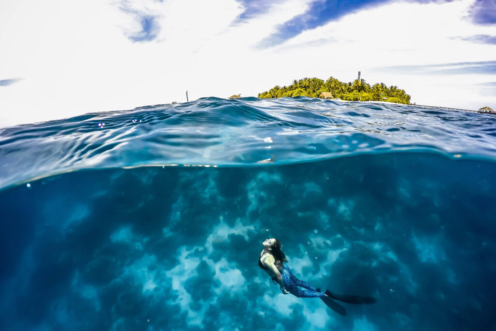 Freediver swimming towards the surface