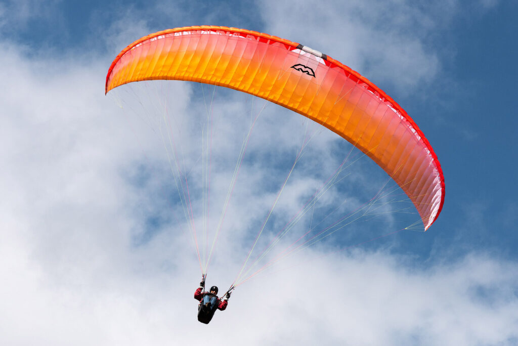 A paraglider up in the sky