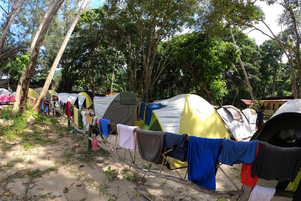 Crowded tents with clothes hanging in front