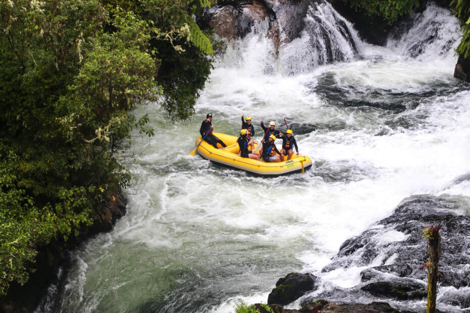 A yellow raft on the rapids