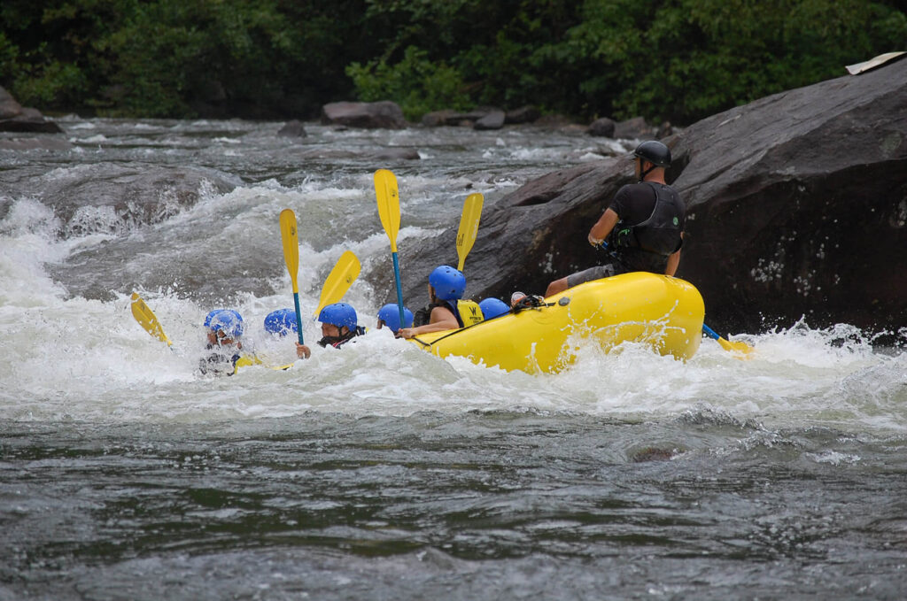 Raft falling into the rapids