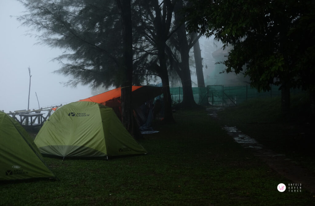 misty campsite with few tent set up