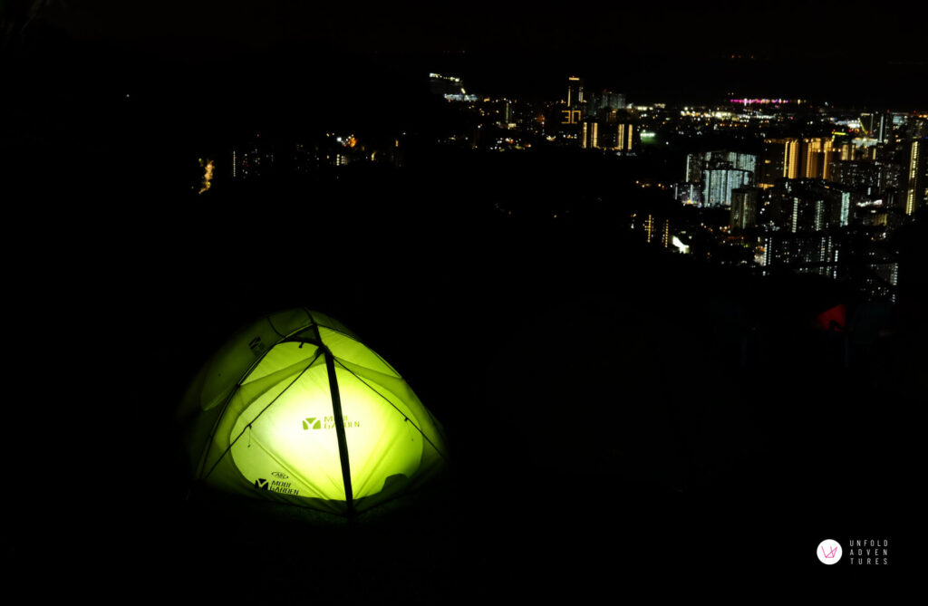 nightscape with a green tent lit up