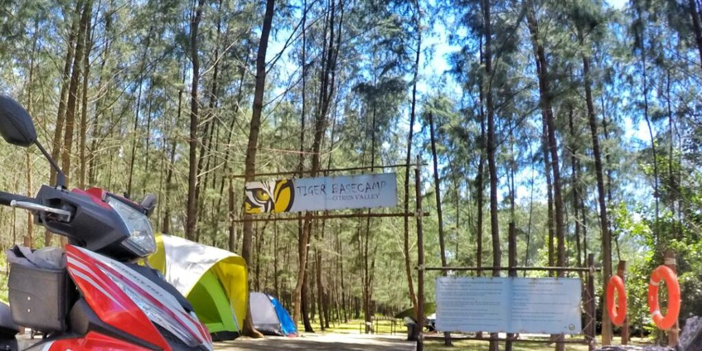 entrance of the campsite with few tents around
