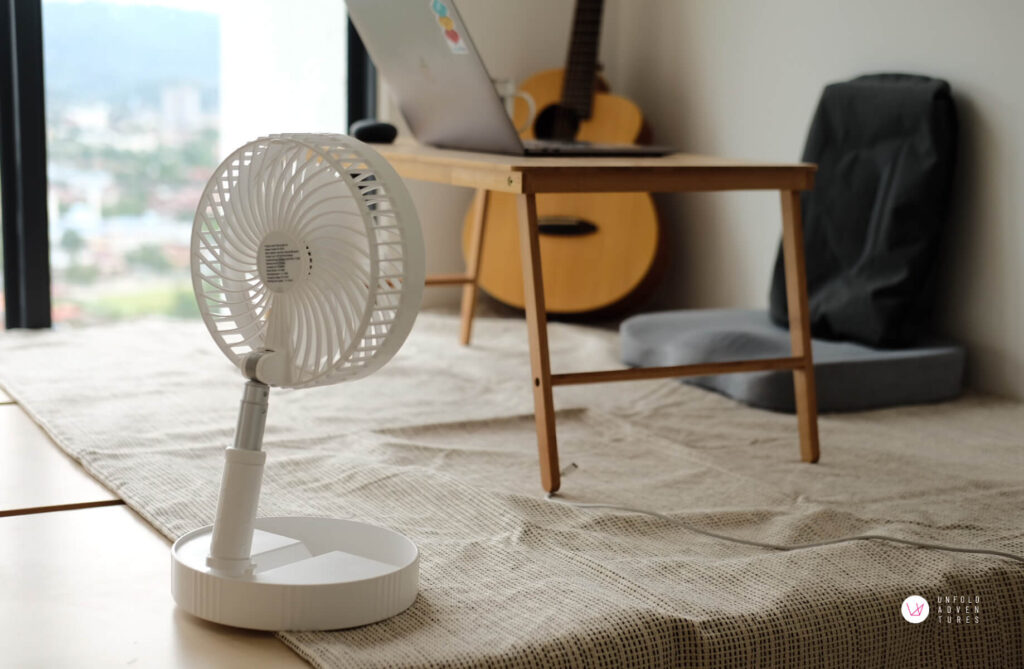 Back view of the portable fan with guitar at the background