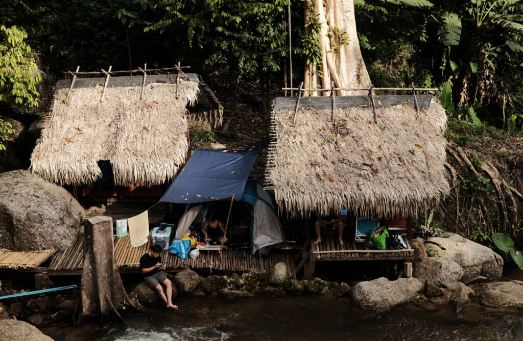 Wooden hut at the river side