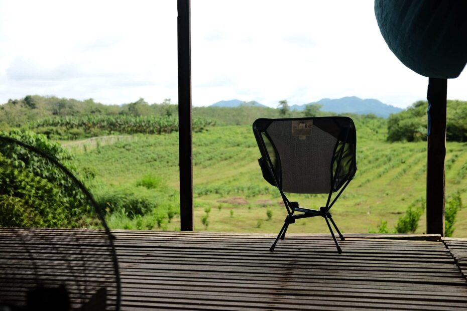 Camping chair in front of a farm