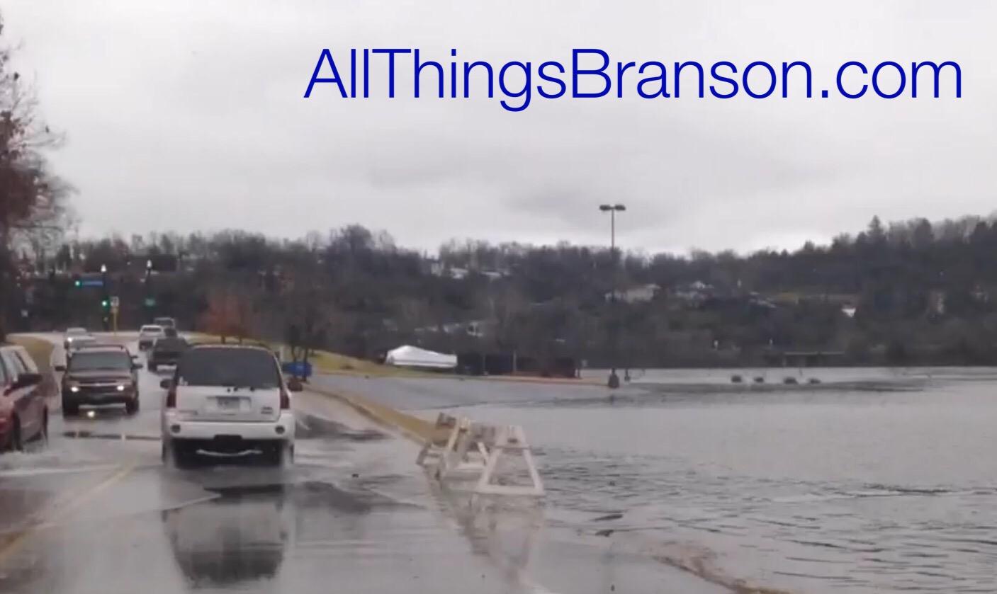 WARNING: Branson Landing Parking Lot Flooding Road