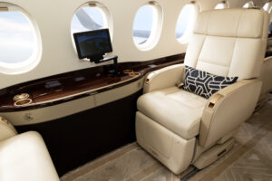 Comfortible cabin chair in a modern business jet during flight. Republic Jet Center