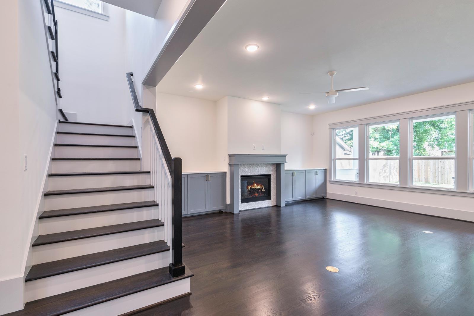Houston-Homebuilder-Custom-Homebuilder-Central-Houston-Homebuilder-Oak-Forest-Family-Room-Fireplace-Modern-Staircase-Railing