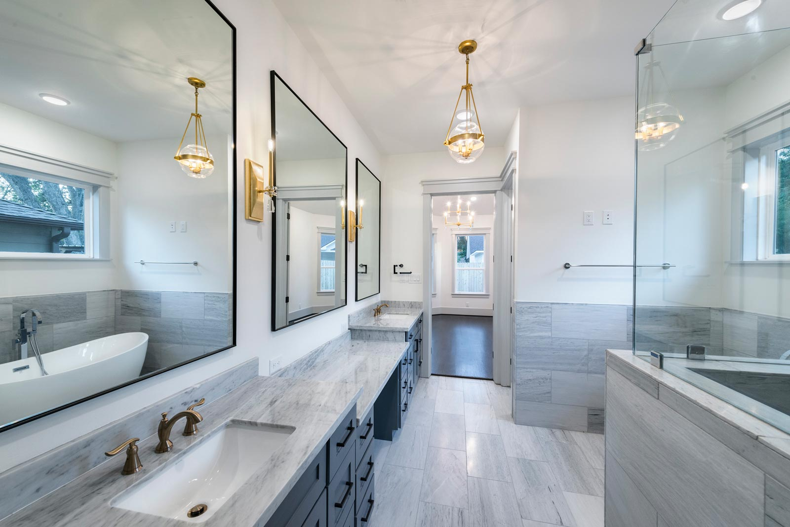 Houston-Homebuilder-Custom-Homebuilder-Central-Houston-Homebuilder-Oak-Forest-Homebuilder-Carrara-Marble-Counters-Gray-Marble-Tile-Steel-Frame-Mirrors-Gold-Sconces