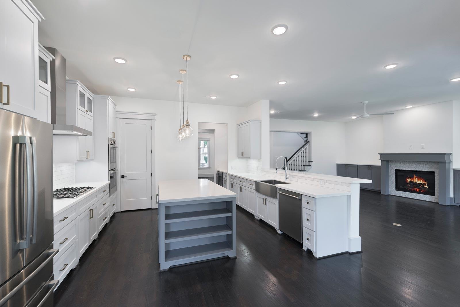 Houston-Homebuilder-Custom-Homebuilder-Central-Houston-Homebuilder-Oak-Forest-Open-Kitchen-Family-Room-Dark-Stain-on-White-Oak-Floors